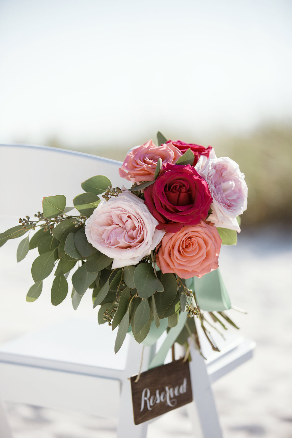 Tropical Beach Wedding Ceremony Decor, White Folding Chair with Blush Pink, Coral and Red Roses with Greenery Florals