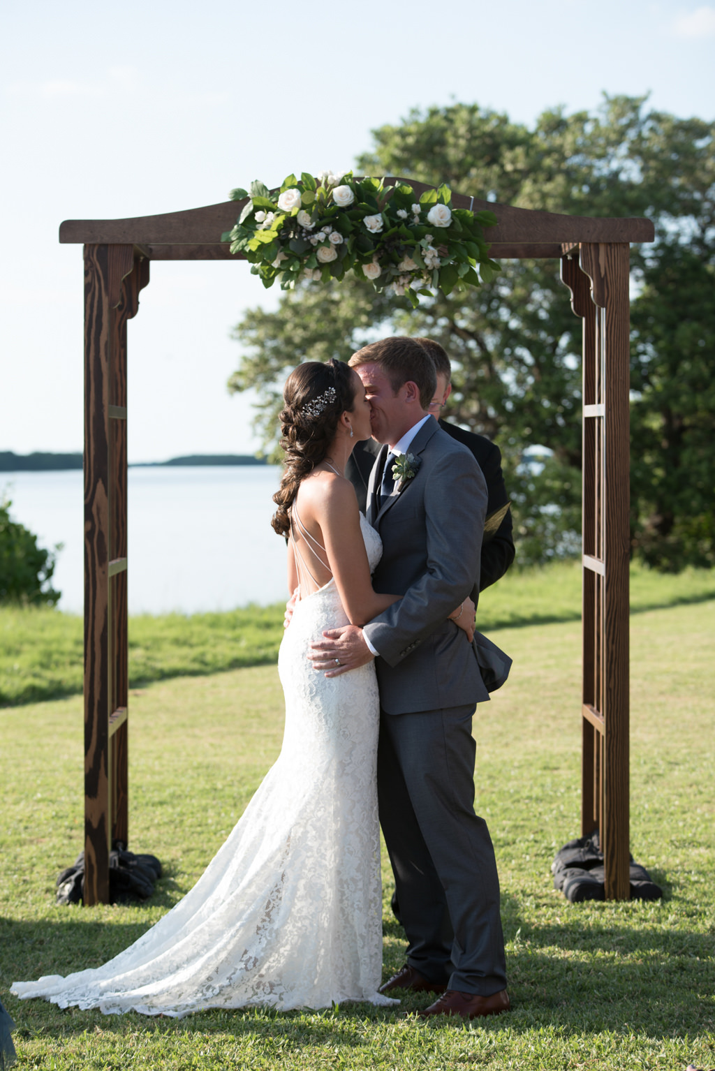 Florida Bride and Groom Outdoor Wedding Ceremony Portrait, Wooden Arch with Greenery and White Floral Bouquet | Tampa Bay Wedding Florist Cotton and Magnolia