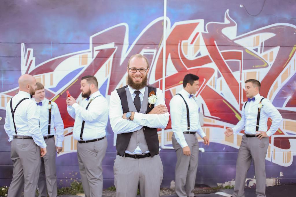 Florida Groom and Groomsmen Wedding Portrait, Groom in Grey and Black Vest and Grey Dress Pants, Groomsmen in Suspenders, Blue Bowties and Grey Pant Suits   Tampa Bay Wedding Photographer Lifelong Photography Studios