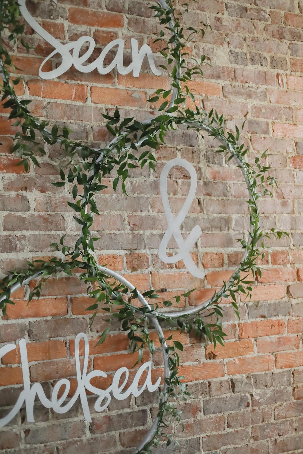 Industrial Wedding Decor Silver Metal Groom and Bride Laser Cut Names in Circular Hoops with Greenery Garland   Tampa Bay Wedding Photographer Lifelong Photography Studios