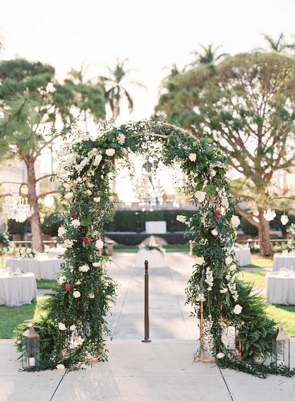 Elegant Modern Garden Courtyard Wedding Ceremony Decor, Greenery, White, Ivory, Red Arch, Gold Candlesticks, Brush Gold Lanterns | Sarasota Wedding Venue Ringling Museum | Tampa Bay Wedding Planner NK Weddings