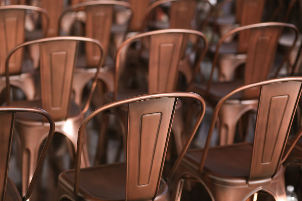 Industrial Inspired Bronze Metal Chairs for Wedding Ceremony   Tampa Bay Wedding Photographer Lifelong Photography Studios   Wedding Rentals A Chair Affair