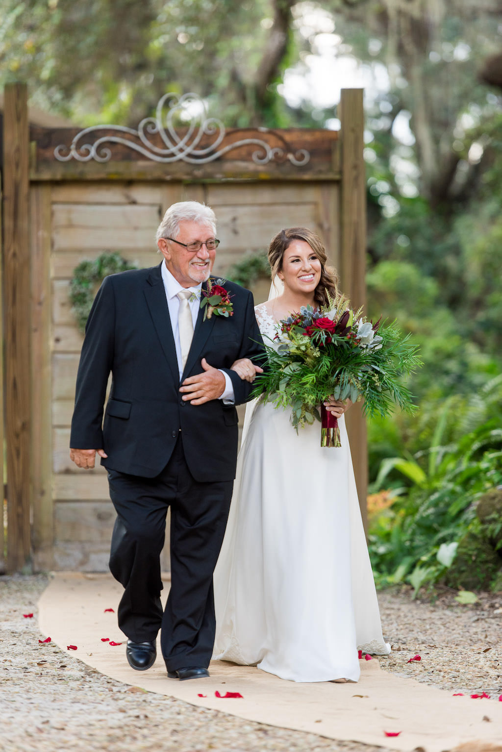 Bride and Father Walking Down the Aisle at Rustic Garden Outdoor Wedding Ceremony