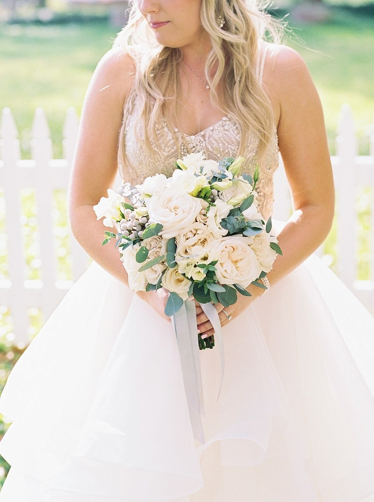 Florida Bride in Watters Nude and Rhinestone Embellished Spaghetti Strap Bodice and Tulle Flowy Skirt Ballgown Wedding Dress with Ivory Garden Rose, Silver Dollar Eucalyptus Greenery Floral Wedding Bouquet | Sarasota Wedding Florist Cotton & Magnolia