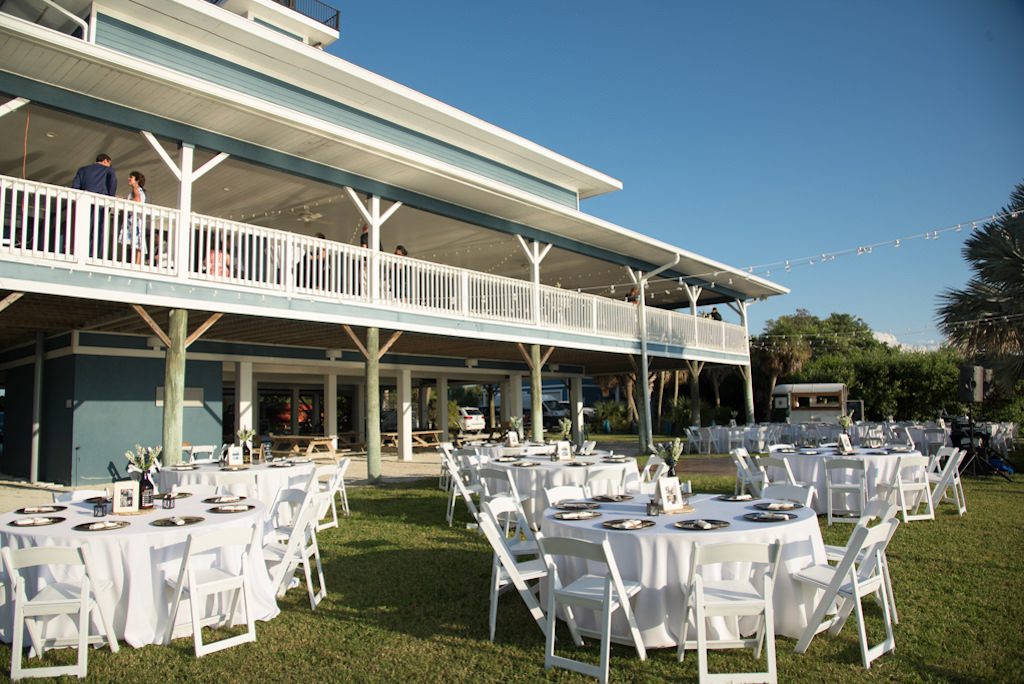 Outdoor Waterfront Florida Wedding Reception Decor, Round Tables with White Tablecloths, White Wooden Folding Chairs | St. Petersburg Wedding Venue Tampa Bay Watch