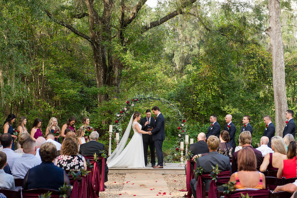 Florida Bride and Groom Exchanging Vows at Rustic Outdoor Garden Wedding Ceremony | Rustic Tampa Bay Wedding Venue Kathleen's Garden