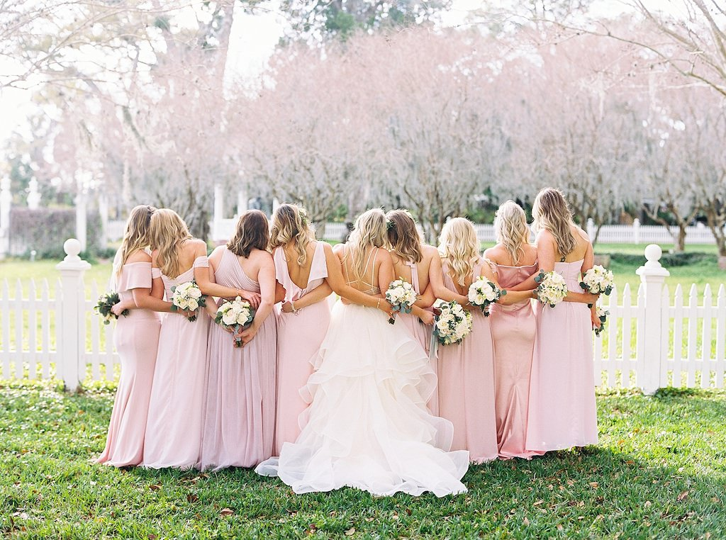 Florida Bride and Bridesmaids Outdoor Wedding Portrait, Bridesmaids in Mismatched Blush Pink Long Dresses, Bride in Watters Flowy Ballgown Strappy Wedding Dress | Palmetto Wedding Florist Cotton & Magnolia