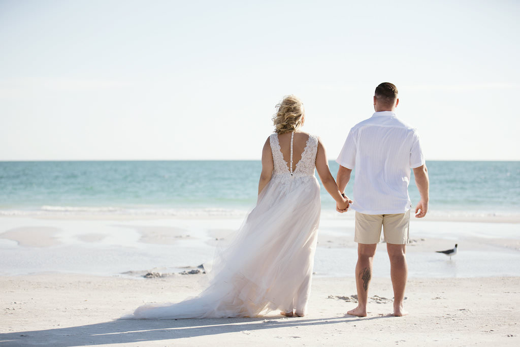 Florida Bride and Groom Wedding Portrait on Beach, Bride in Lace and Tulle A-Line Low Back with Buttons Tank Top Strap Wedding Dress | Tampa Bay Bridal Boutique Truly Forever Bridal