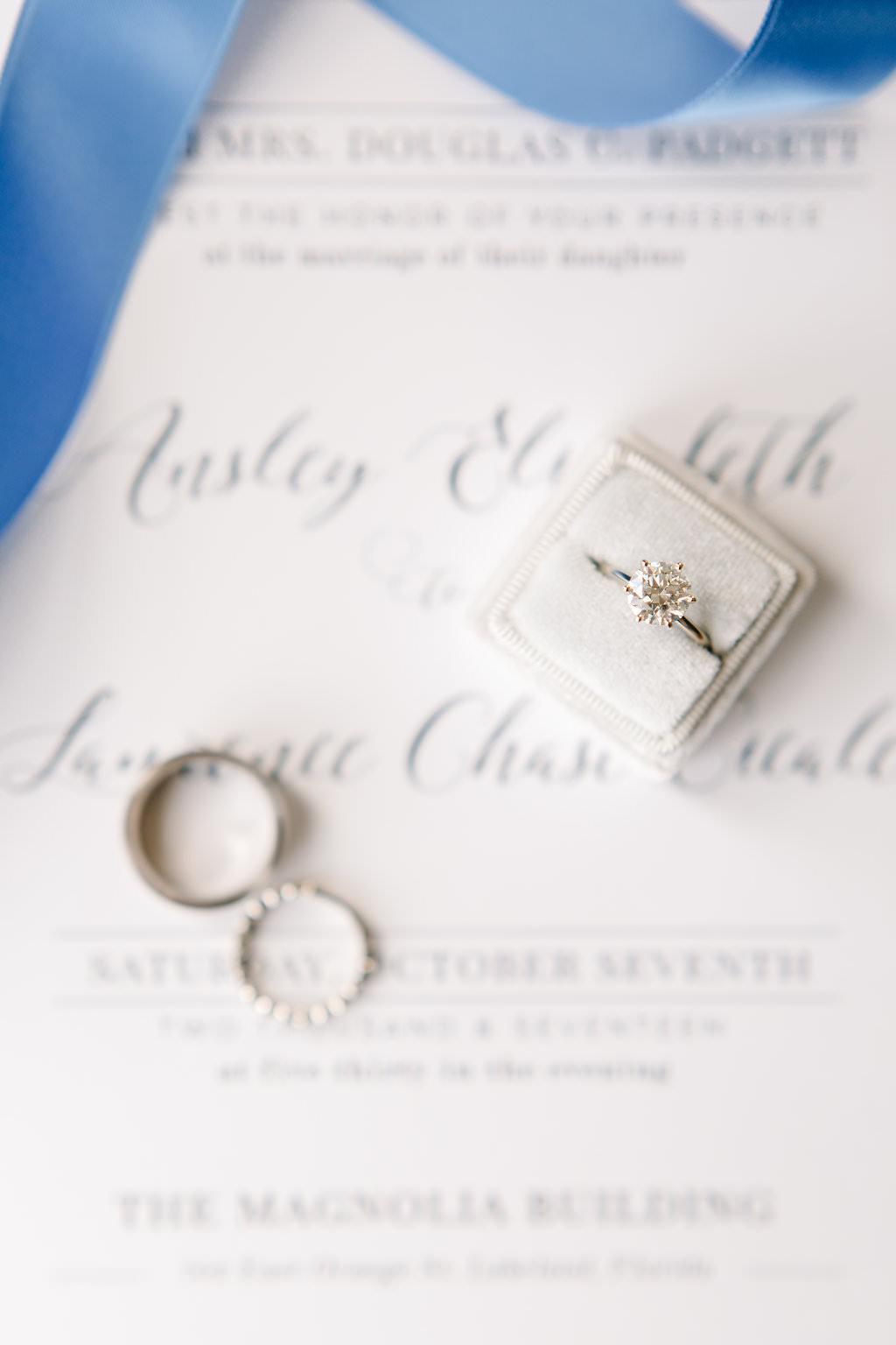 Round Diamond Engagement Ring in Grey Velvet Ring Box on Wedding Invitation