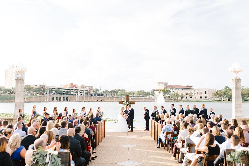 Florida Bride and Groom Wedding Ceremony Exchanging Vows Wedding Portrait   Lakeland Wedding Venue Lake Mirror Amphitheater   Tampa Wedding Planner Love Lee Lane
