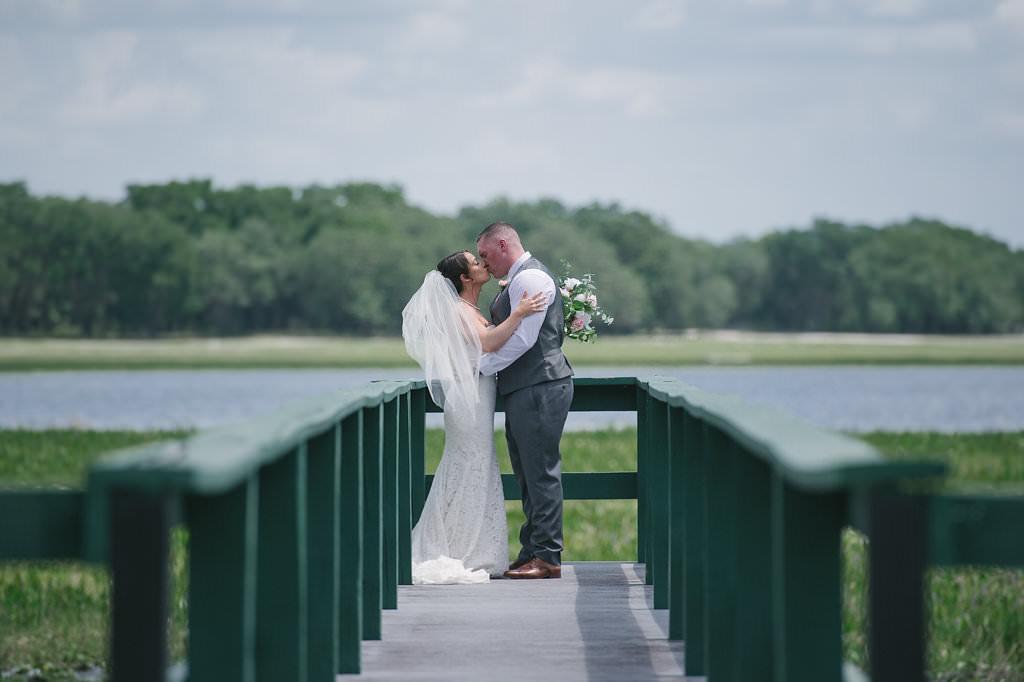 Tampa Bay Bride and Groom Outdoor Lakefront Deck Wedding Portrait | Florida Rustic Wedding Venue Lakeside Ranch