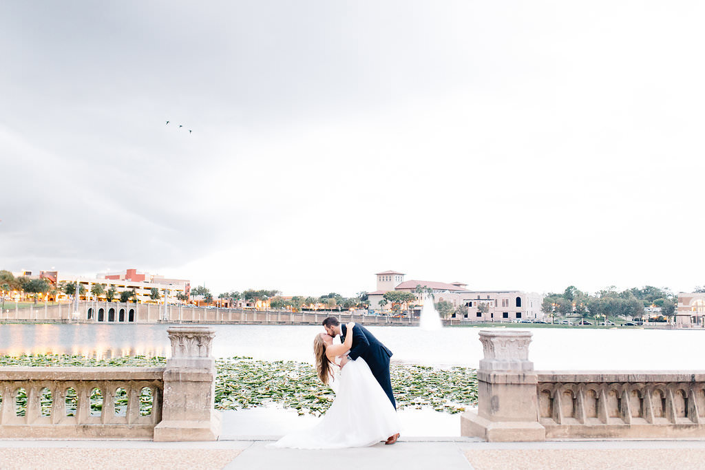 Tampa Bay Outdoor Lakefront Bride and Groom Wedding Portrait | Lakeland Wedding Venue Lake Mirror Amphitheater | Planner Love Lee Lane