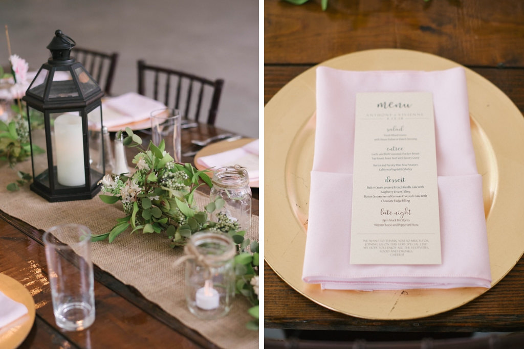 Rustic Wedding Reception Decor, Long Wooden Table with Black Lantern, Greenery Garland Centerpiece, Burlap Table Runner, Gold Charger, Blush Pink Linen, and Menu