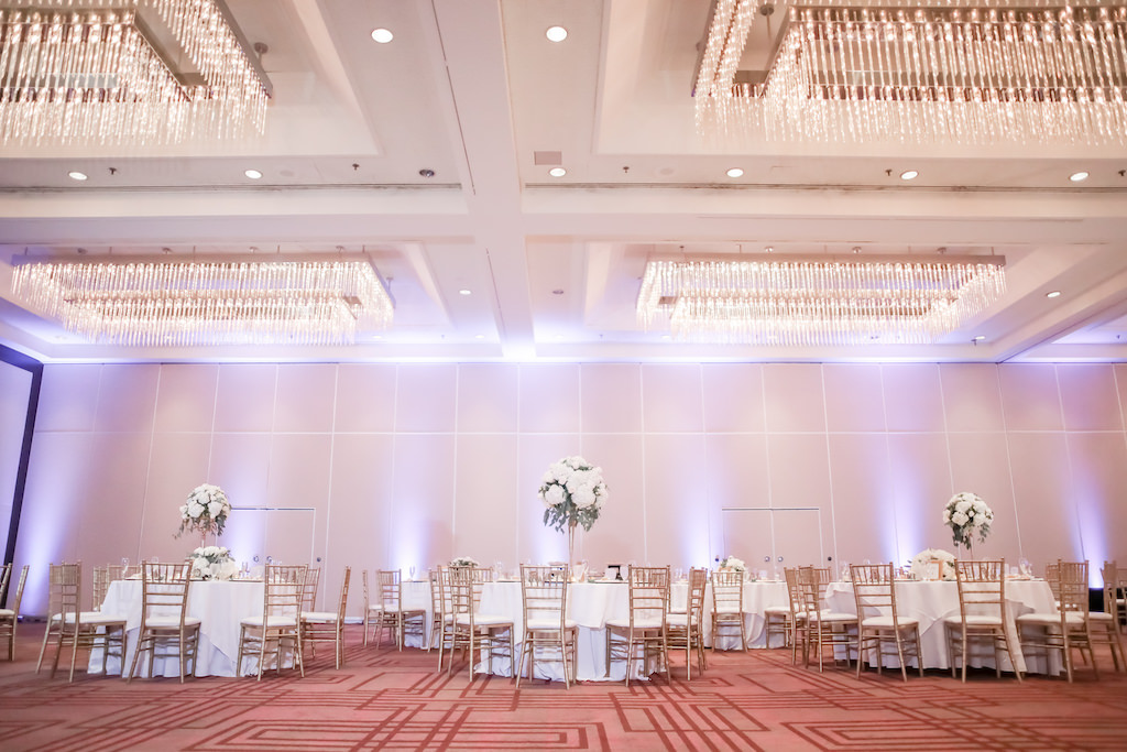 Wedding Hotel Ballroom with Chandeliers Round Tables with White Tablecloths, Gold Chiavari Chairs and Tall White Floral Centerpieces at Hilton Downtown Tampa Wedding Venue | Tampa Bay Wedding Photographer Lifelong Photography Studio