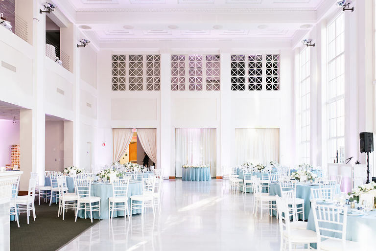 Elegant, Classic White and Dusty Blue Wedding Reception Decor with Round Tables, Dusty Blue Tablecloths, White Chiavari Chairs and Low Centerpieces | Historic Downtown Tampa Wedding Venue The Vault