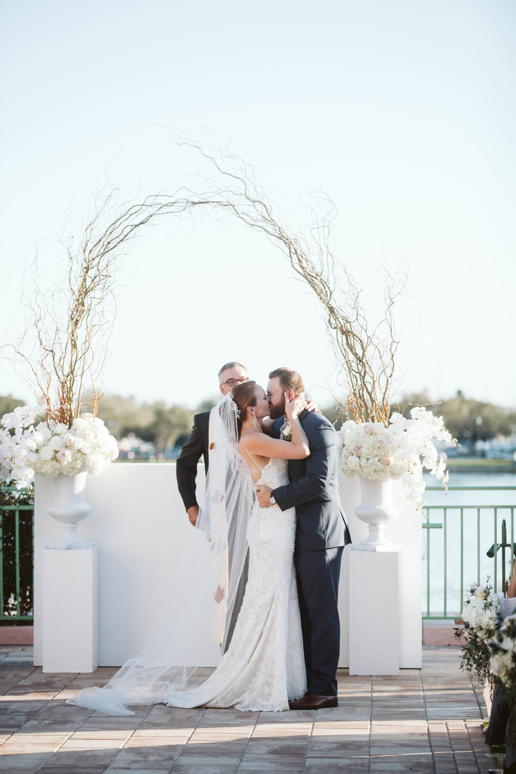 Outdoor Lawn Florida Wedding Ceremony with manzanita branches arch decor and white flowers | Historic Downtown Hotel Venue St. Pete Vinoy Renaissance | Tampa Bay Planner Parties a la Carte