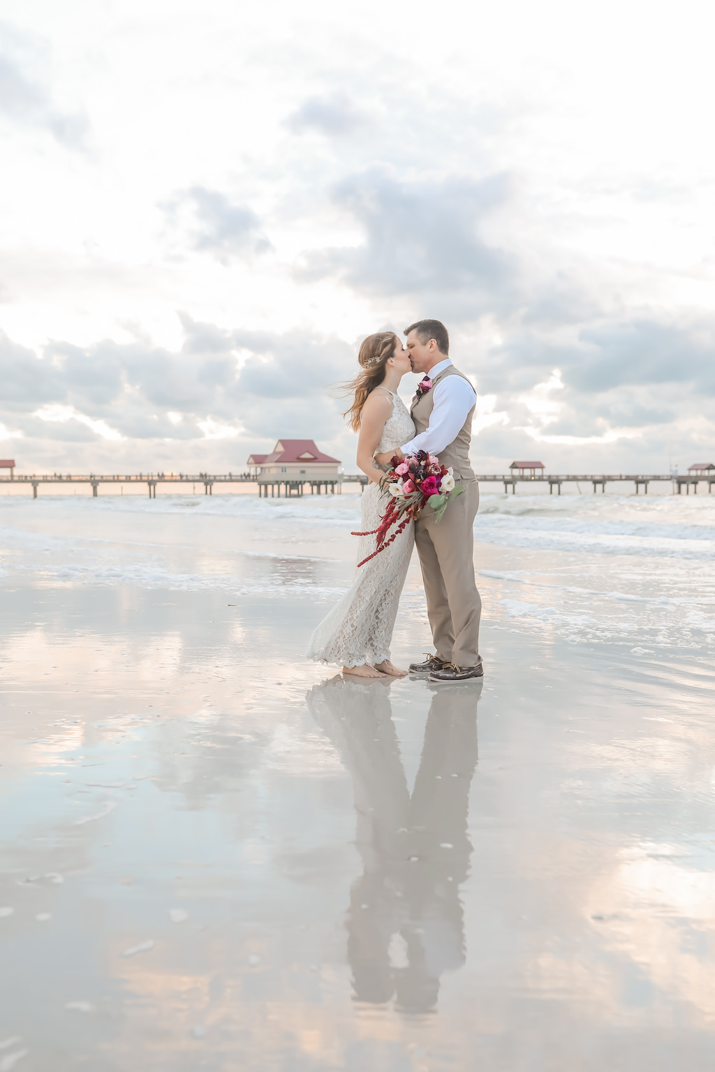Florida Bride and Groom Sunset Wedding Portrait on the Beach | Tampa Bay Wedding Photographer Lifelong Photography Studios | Clearwater Beach Hotel Wedding Venue Hilton Clearwater Beach
