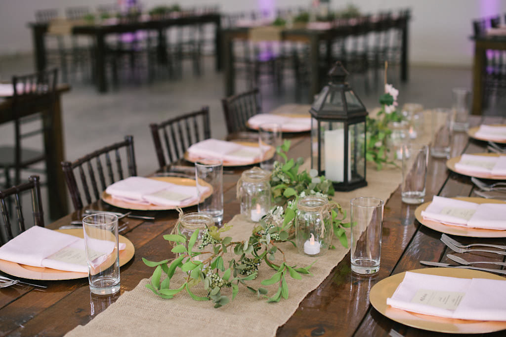 Tampa Bay Wedding Reception Decor, Long Wooden Table, Burlap Table Runner, Greenery Garland, Black Lantern Centerpiece, Gold Charger and Blush Pink Linens