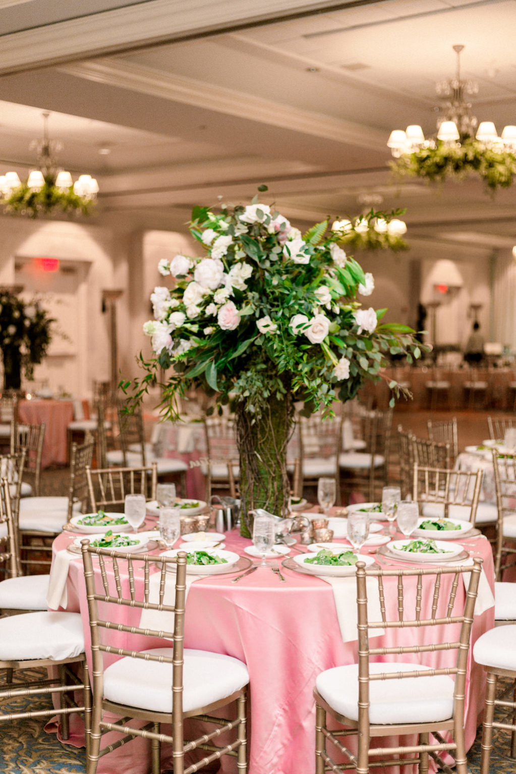 Florida Ballroom Wedding Reception Decor, Round Table with Pink Tablecloth, Gold Chiavari Chairs, Tall Greenery, Ivory and Blush Pink Floral Centerpiece | Wedding Venue Tampa Bay Marriott Waterside | Wedding Rental Company A Chair Affair | Over the Top Rental Linens