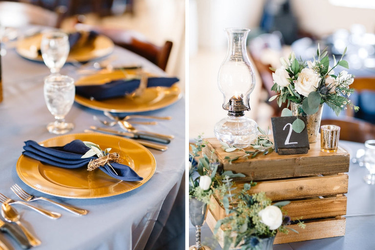 Vintage Rustic Whimsical Inspired Wedding Reception Decor, Round Table with Dusty Blue Tablecloth, Gold Chargers, Navy Blue Linens, Wooden Pallet Box with Candelsticks, Vases with Greenery and White Floral Centerpieces | Tampa Bay Wedding Planner Love Lee Lane | Rentals A Chair Affair