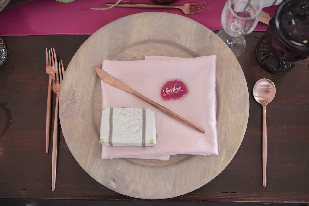 Travel Inspired Wedding Reception Decor, Wooden Charger with Blush Pink Linen, Rose Gold Silverware, Agate Slice Quartz Place Card and Suitcase Wedding Favor Box | Tampa Bay Wedding Photographer Lifelong Photography Studios