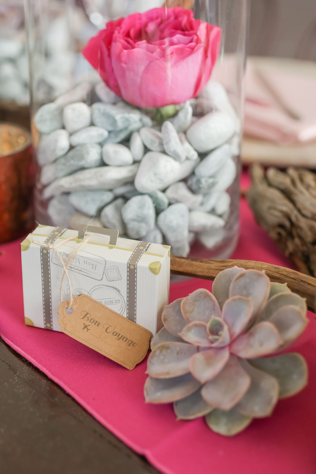 Travel Inspired Wedding Reception Decor, Hot Pink Table Runner, Glass Vase withe Rocks and Pink Garden Rose, Succulent and Small Suitcase Wedding Favor Box | Tampa Bay Wedding Photographer Lifelong Photography Studios