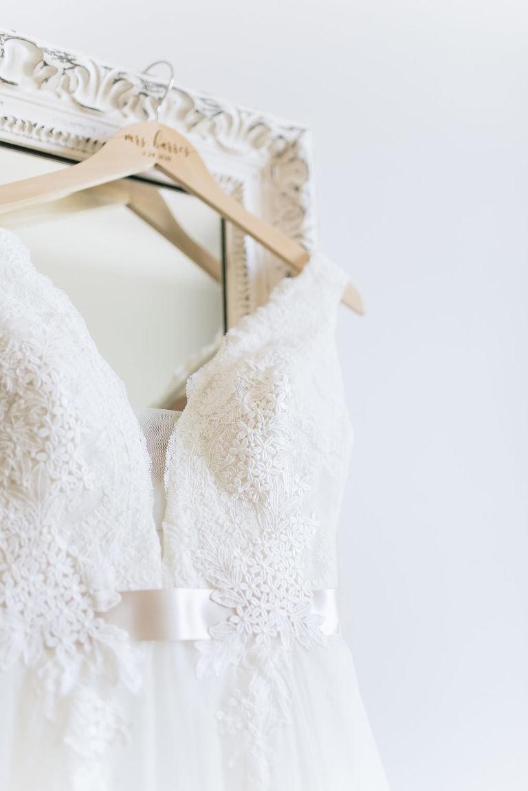 Lace Tank Top Deep V-Neck Wedding Dress with Satin Ivory Ribbon on Custom Wooden Hanger