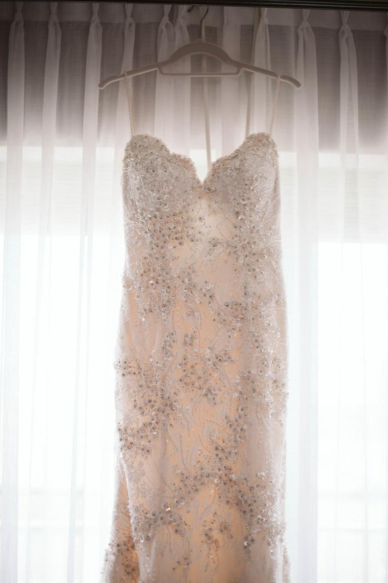 Lace sweetheart wedding dress with rhinestone embellishments
