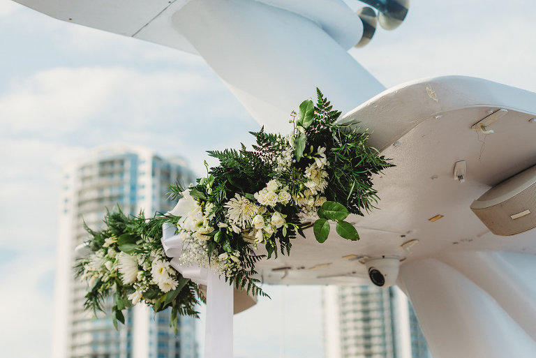 Tampa Outdoor Waterfront Wedding Ceremony Decor, Greenery and White Florals | Tampa Waterfront Wedding Venue Yacht Starship IV