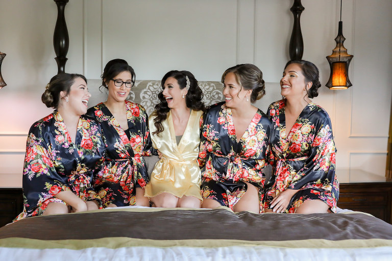 Florida Bride and Bridesmaids Getting Ready Wedding Portrait in Floral Matching Robes, Bride in Yellow Robe | Tampa Bay Wedding Photographer Lifelong Photography Studio | St. Pete Wedding Hair and Makeup Artist Destiny and Light