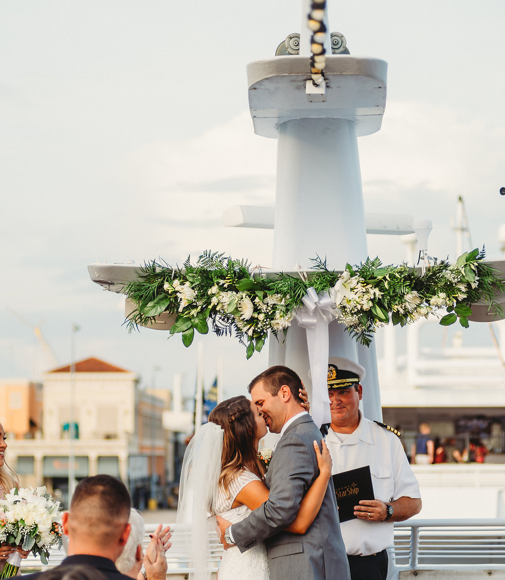 Florida Bride and Groom Wedding Ceremony First Kiss Portrait | Tampa Waterfront Wedding Venue Yacht Starship IV