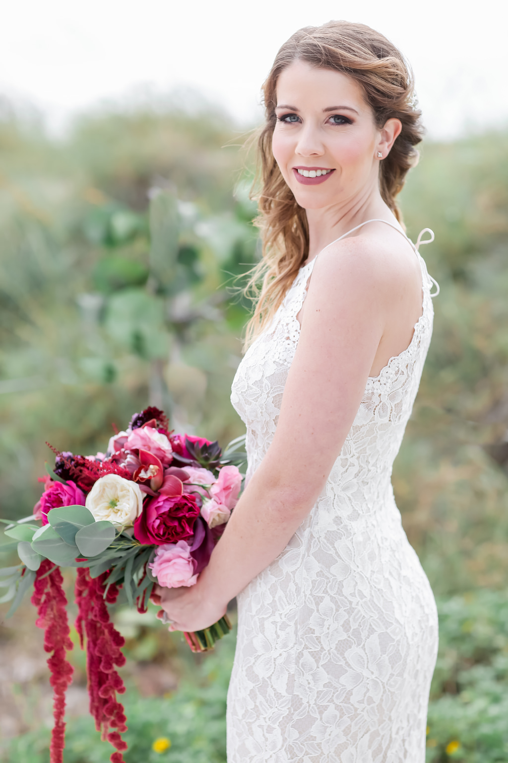 Florida Bride Wedding Portrait in Fitted Lace Halter Strap BHLDN Wedding Dress with Jewel Tone, Purple, Plum, Pink, White, and Greenery Organic Bridal Bouquet | Tampa Bay Wedding Photographer Lifelong Photography Studios | Hair and Makeup Artist Femme Akoi