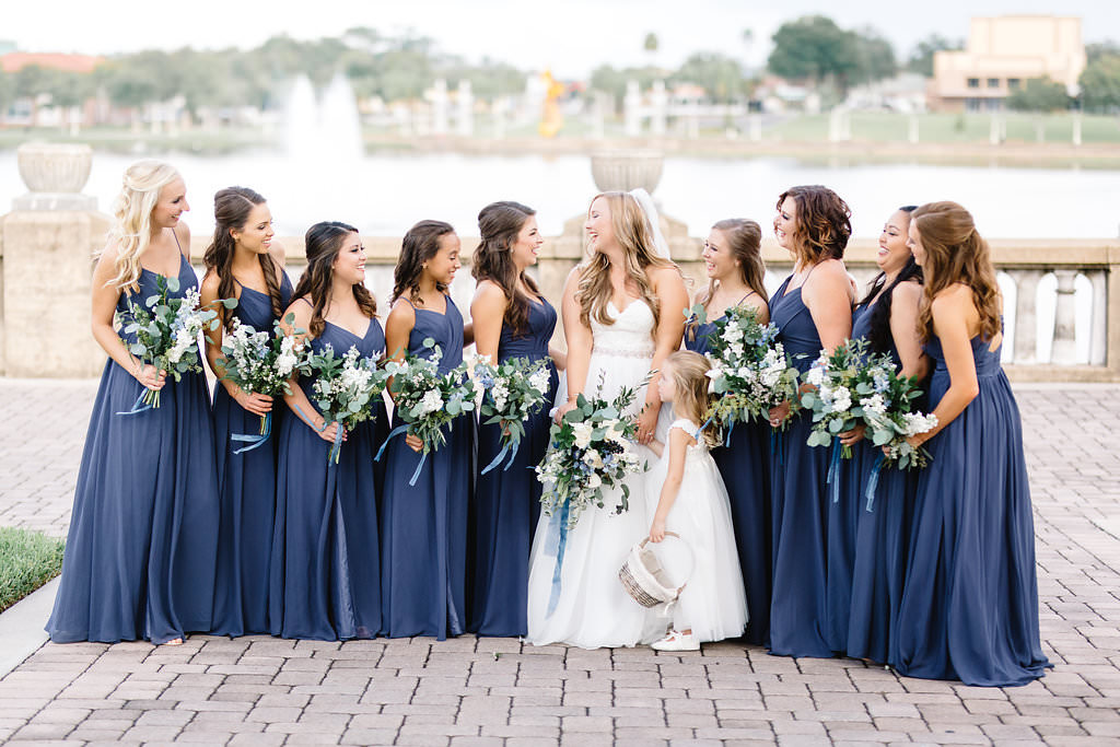 Tampa Bay Bride and Bridesmaids Outdoor Wedding Portrait, Bridesmaids Matching Long Navy Blue Dresses, Bride in Strapless Sweetheart Lace Bodice, Tulle and Organza Ball Gown Skirt Essense of Australia Wedding Dress with Wild Organic White, Blue, Silver Dollar Eucalyptus Greenery Floral Bouquets   Lakeland Wedding Venue Lake Mirror Amphitheatre