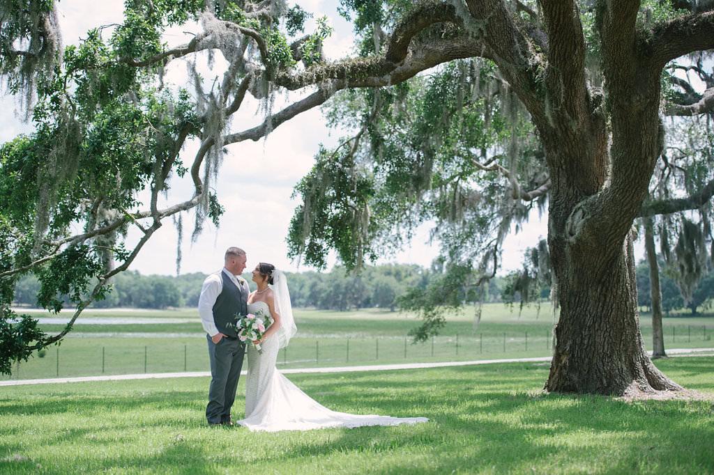 Florida Bride and Groom Outdoor Wedding Portrait | Florida Rustic Wedding Venue Lakeside Ranch