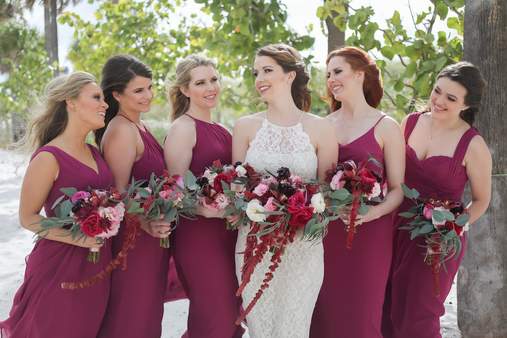 Florida Bride and Bridesmaids Wedding Portrait, Bridesmaids in Pinkish Purple Magenta Long Mismatched Style Dresses, Bride in Long Lace Fitted Halter Strap BHLDN Wedding Dress with Jewel Tone Organic Purple, Pink, Plum, White and Greenery Floral Bouquets | Tampa Bay Wedding Photographer Lifelong Photography Studios | Hair and Makeup Artist Femme Akoi