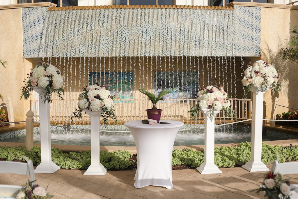 Outdoor Lawn Ceremony Decor, Unity Table with Plant, Tall White Pedestals with Ivory, Blush Pink, Greenery Floral Bouquets   Tampa Bay Wedding Photographer Lifelong Photography Studios   Clearwater Beach Wedding Hotel Venue Sandpearl Resort   Wedding Planner Special Moments Event Planning