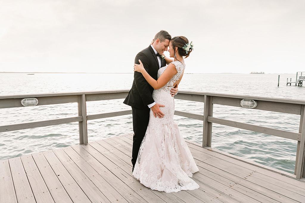 Tampa Bay Waterfront Bride and Groom Wedding Portrait Walking on Pier | Intimate Dunedin Wedding Venue Beso Del Sol