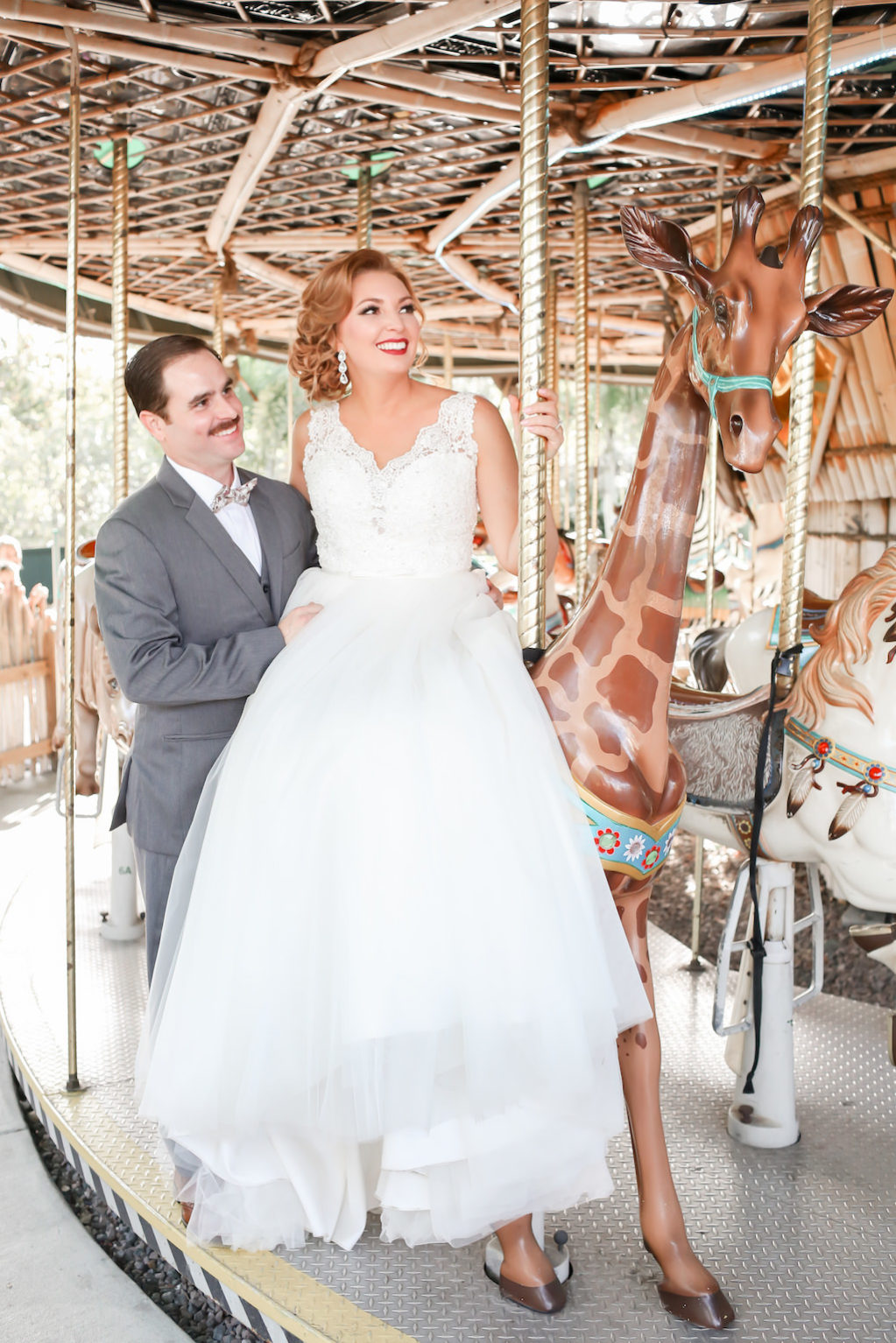 Florida Bride and Groom Riding Carousel Wedding Portrait | Tampa Bay Wedding Photographer Lifelong Photography Studio | Hair and Makeup Michele Renee the Studio | Tampa Unique Wedding Venue ZooTampa at Lowry Park