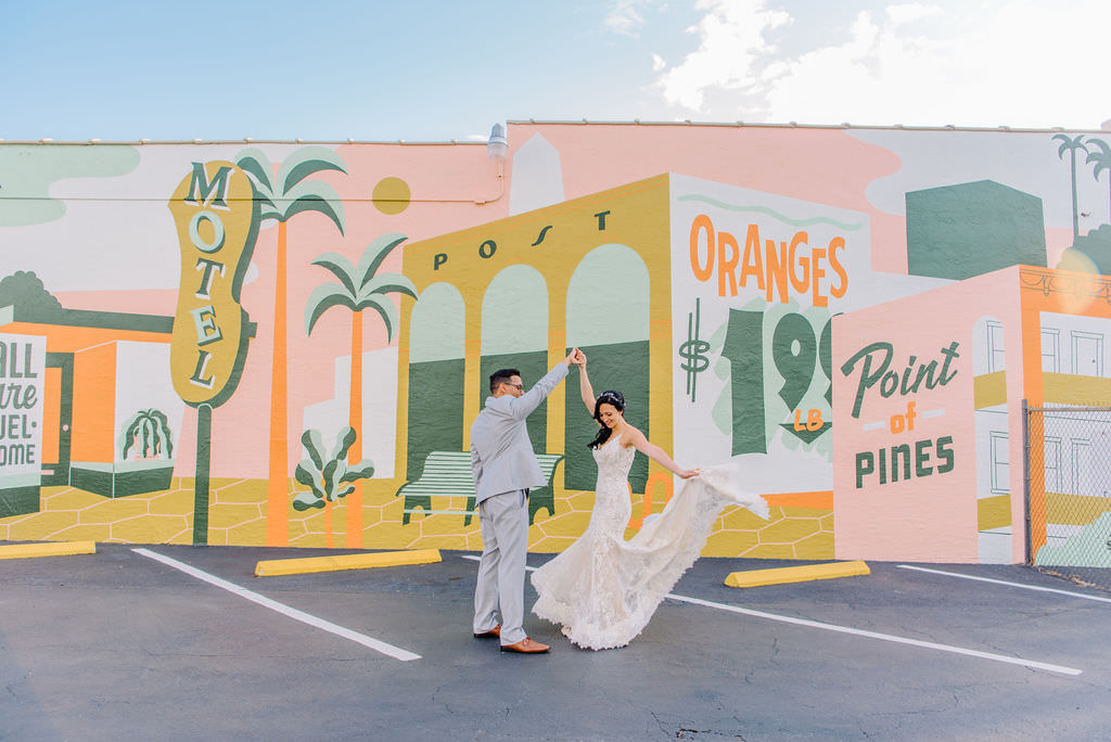 Downtown St. Pete wedding portraits in front of colorful graffiti mural by J&S Signs Shine Mural 2018 Tampa Bay Wedding Photographer Kera Photography
