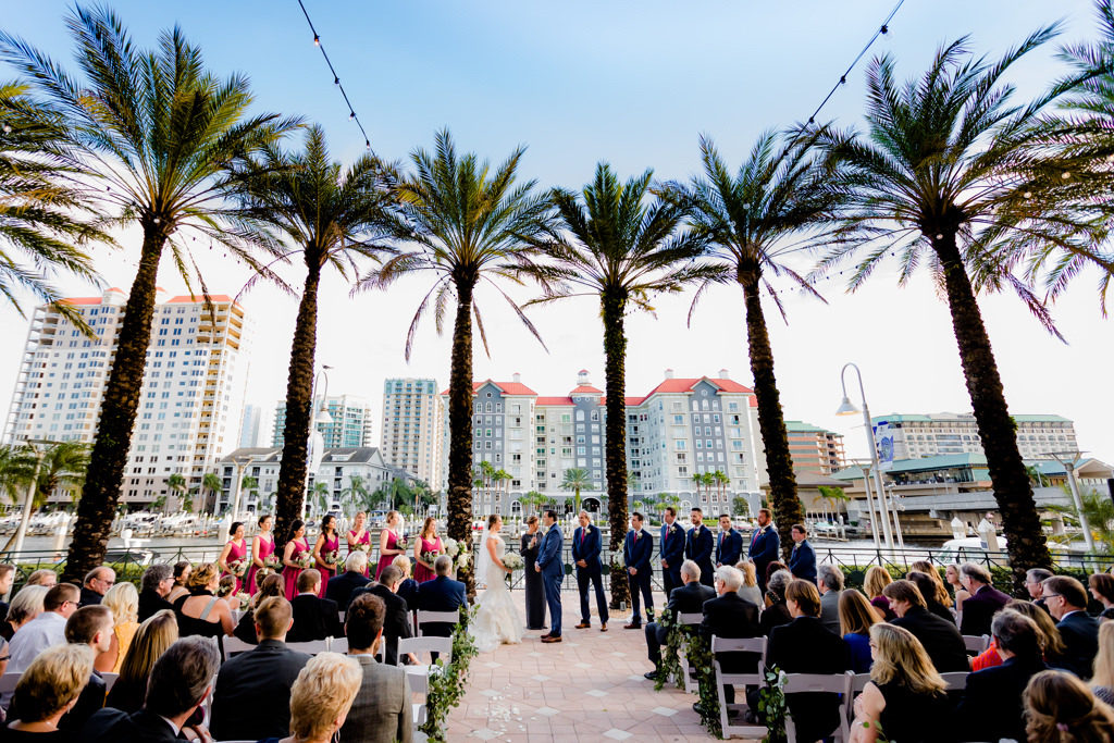 Tampa Bay Bride and Groom Exchanging Vows Waterfront Wedding Ceremony Portrait | Wedding Venue Tampa Marriott Water Street | Planner Special Moments Event Planning