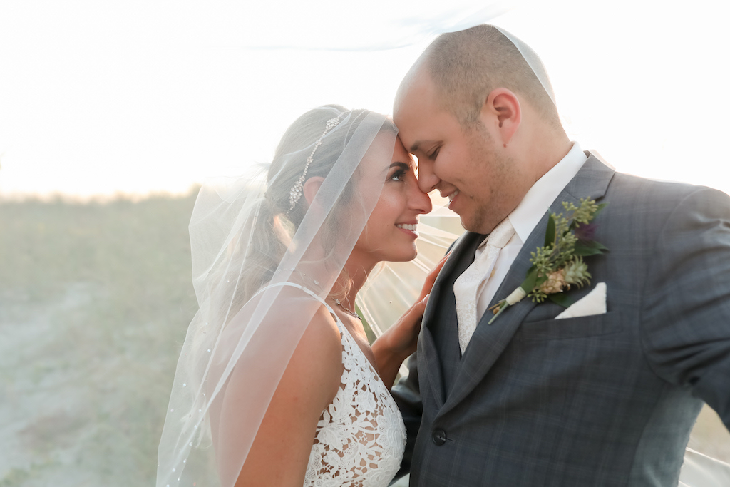 Florida Bride and Groom Sunset Creative Veil Wedding Portrait   Tampa Bay Wedding Photographer Lifelong Photography Studios   Planner Special Moments Event Planning
