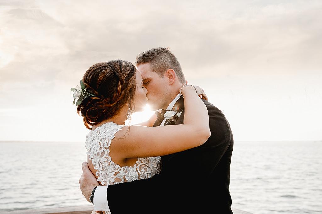 Florida Bride and Groom Waterfront Sunset Wedding Portrait | Intimate Dunedin Wedding Venue Beso Del Sol