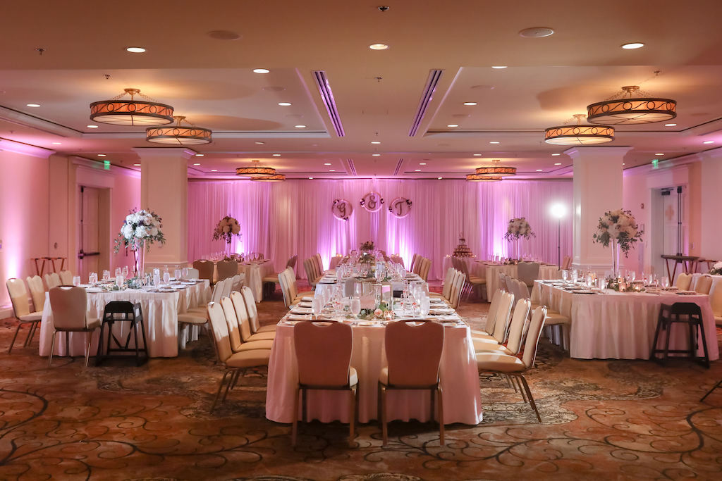 Romantic Hotel Ballroom Wedding Reception Decor, Long Tables with White Tablecloths, Pink Uplighting   Tampa Bay Wedding Photographer Lifelong Photography Studios   Clearwater Beach Hotel Wedding Venue Sandpearl Resort   Wedding Planner Special Moments Event Planning