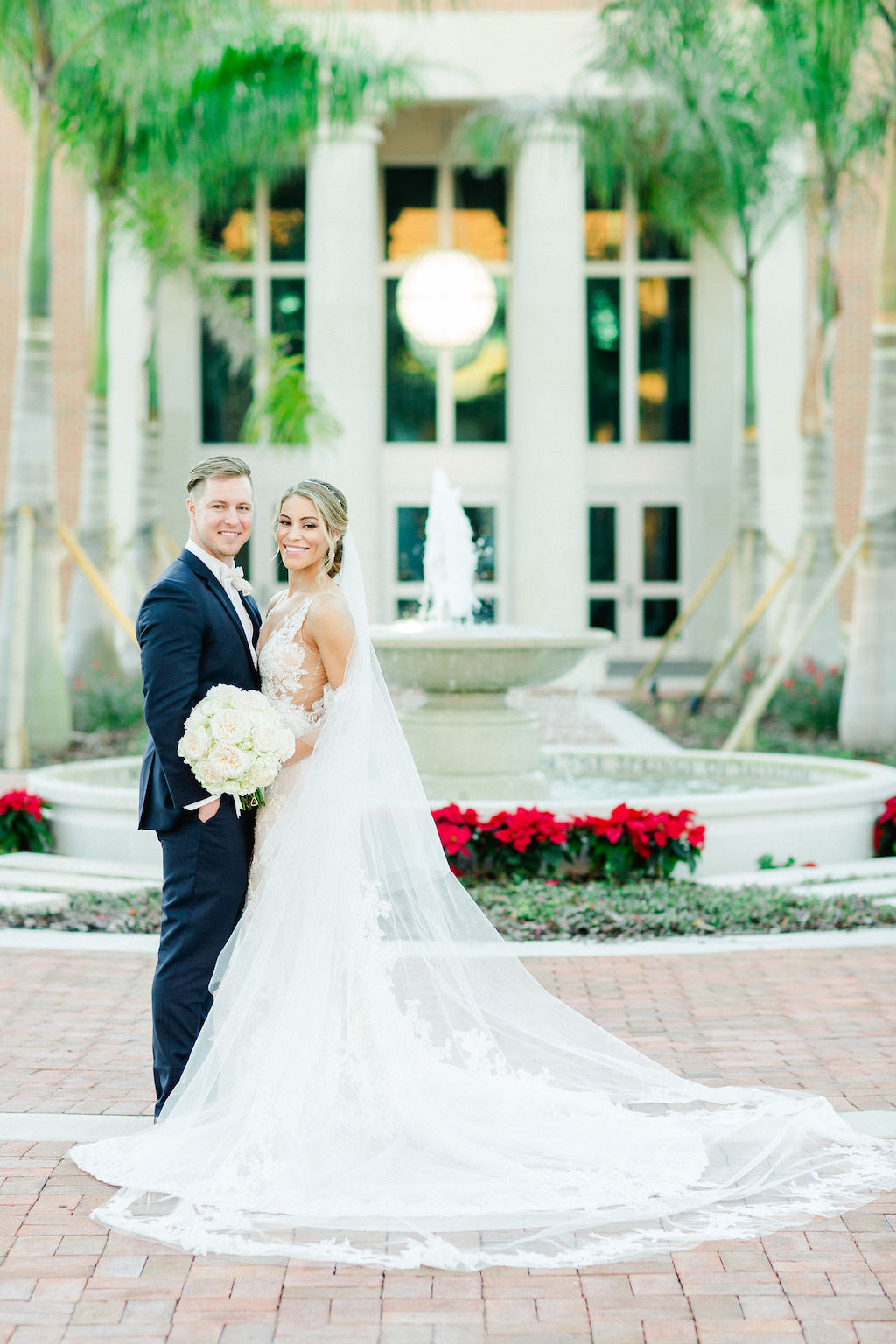 Tampa Bay Outdoor Courtyard Bride and Groom Wedding Portrait, Bride in Long Cathedral Veil and Ivory Rose Floral Bouquet