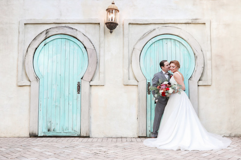 Outdoor Florida Bride and Groom Wedding Portrait with Teal Door Backdrop | Tampa Bay Wedding Photographer Lifelong Photography Studio | Tampa Unique Wedding Venue ZooTampa at Lowry Park | Hair and Makeup Michele Renee the Studio
