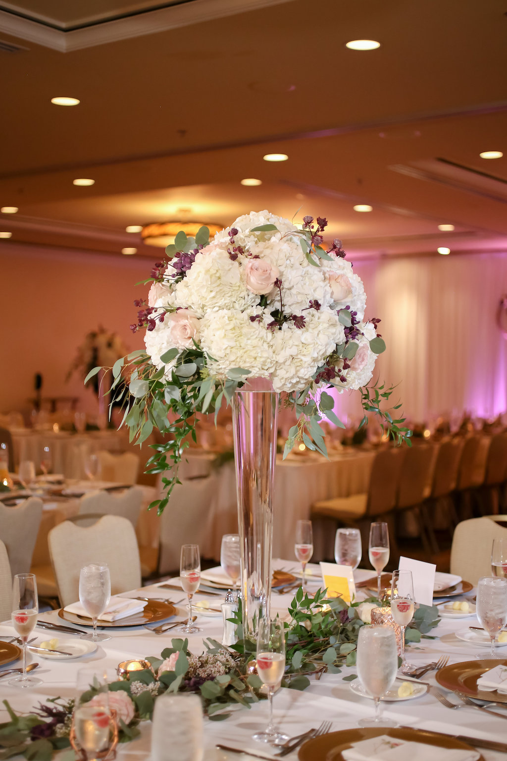 Ballroom Wedding Reception Decor, Long Table with White Tablecloth, Tall Glass Cylinder Vase with White Hydrangeas, Blush pink Roses, and Greenery Flower Centerpiece, Greenery Garland   Tampa Bay Wedding Photographer Lifelong Photography Studios   Wedding Planner Special Moments Event Planning   Clearwater Beach Hotel Wedding Venue Sandpearl Resort