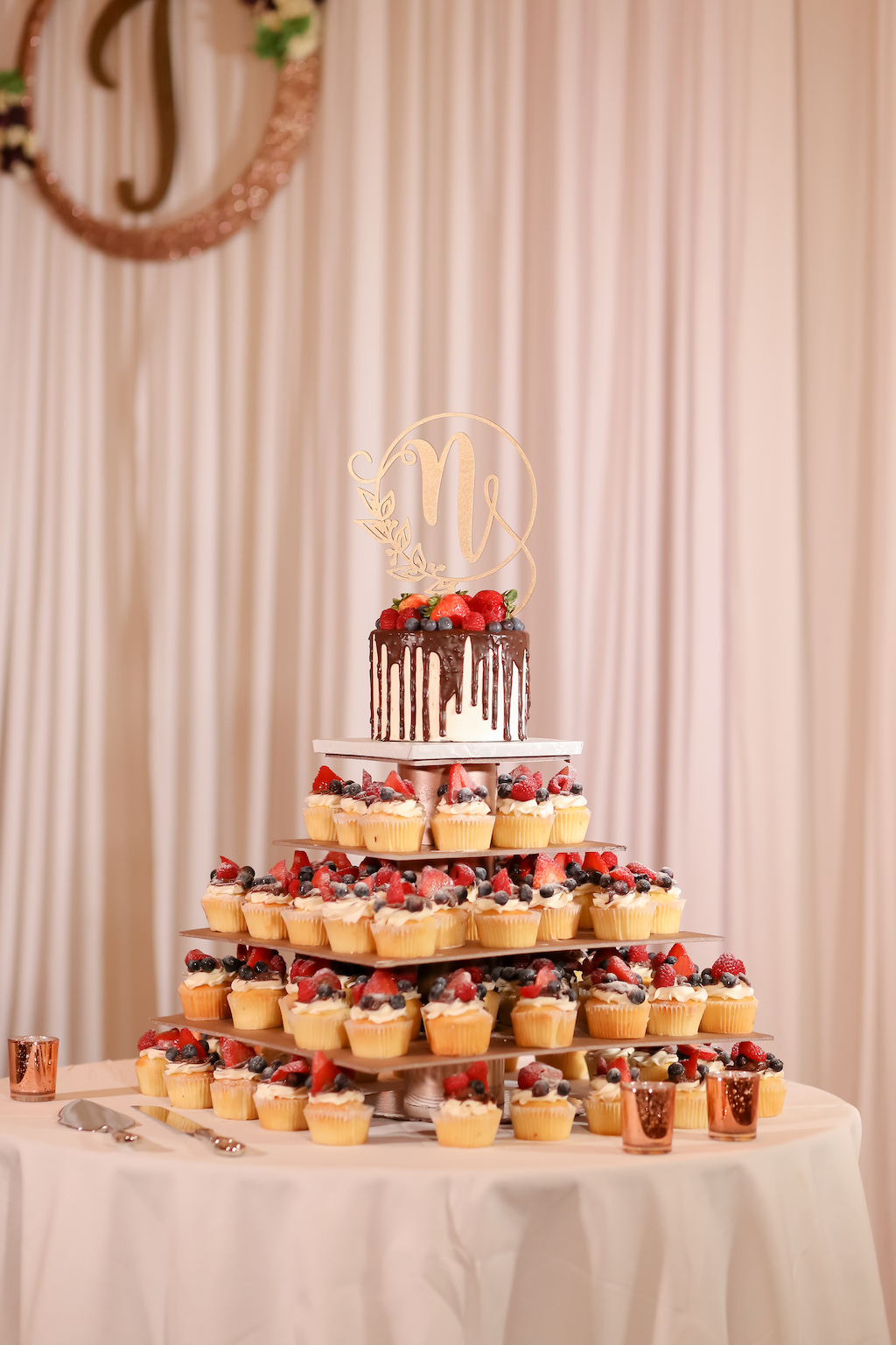 Wedding Reception Dessert Table, One Tier White and Chocolate Drip Wedding Cake with Strawberries and Gold Laser Cut Cake Topper on Cupcake Tier   Tampa Bay Wedding Photographer Lifelong Photography Studios   Wedding Planner Special Moments Event Planning