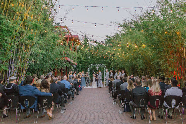 Bamboo garden ceremony under string lights in St. Pete at NOVA 535 | Tampa Bay Wedding Photographer Kera Photography