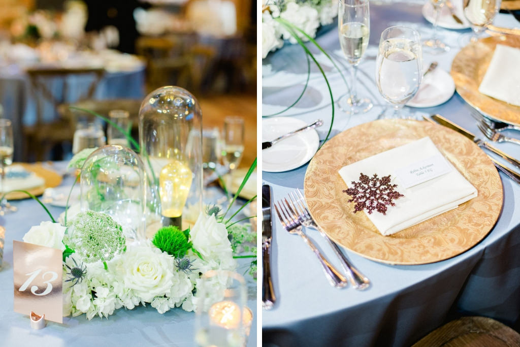 Unique Winter Wonderland Wedding Reception Decor, Satin Light Blue Tablecloth, Gold Chargers, White, Greenery Florals and Glass Cylinders with Lightbulbs Centerpiece, Rose Gold Table Number