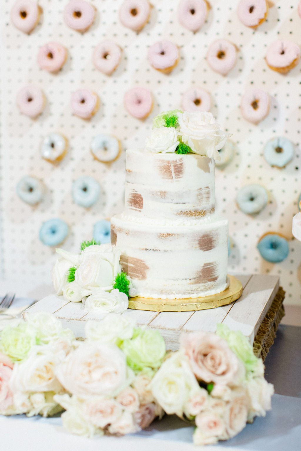 Two Tier Semi Naked Wedding Cake with Ivory Rose Cake Toppers, Donut Wall Backdrop